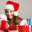 Cute girl with christmas presents — ストック写真