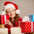 Cute girl with christmas presents — Stockfoto