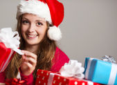 Cute girl with christmas presents — Stock Photo