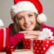 Cute girl with christmas presents — Stok fotoğraf