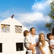 Family building a new house — Stock Photo