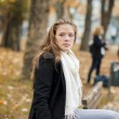 Woman in the city park — Stock Photo