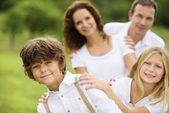 Big family is relaxing in green nature — Stock Photo