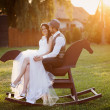 Bride and groom with a horse — Stockfoto
