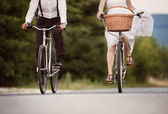 Bride and groom on the bikes — Stock Photo