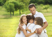 Children and dad hugging — Stock Photo
