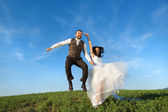 Newly married couple portrait with blue sky — Stock Photo