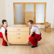 Movers in new house — Stock Photo #39346637