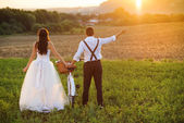 Bride and groom with a white wedding bike — Stock Photo
