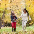 Mother and daughter are having fun in autum nature — Stock Photo #42042461