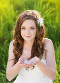 Beautiful spring girl with flowers on the meadow — Stock Photo