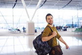 Happy man at the airport is going for holiday — Stock Photo