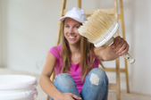 Woman painting the walls. — Stock Photo