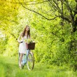 Young woman with bike — Stock Photo #43129459