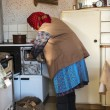Old woman in the kitchen — Stock Photo #44055451