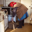 Old woman in the kitchen — Stock Photo #44055665