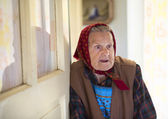 Old woman at home — Stock Photo