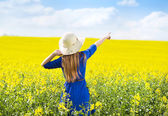 Girl in colza field — Stock Photo