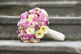 Wedding bouquet on stair — Stock Photo