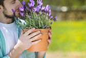 Gardener holding a pot — Stock Photo