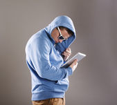 Dangerous man with tablet — Stock Photo