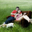 Couple relaxing on couch — Foto de Stock   #45758725