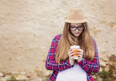 Girl enjoying her take away drink — Stock Photo