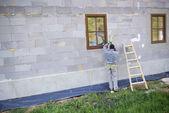 Man applying foam to insulate window — Stock Photo