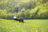 Farmer is relaxing in wheelbarrow — Stock Photo