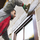 Plasterer spreading out plaster — Stock Photo