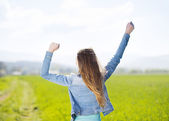 Girl in green field — Stock Photo