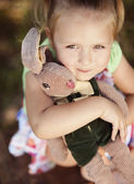 Girl holding her toy — Stock Photo
