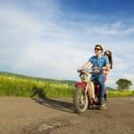 Couple on retro motorbike — Stock Photo #46524235