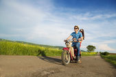 Couple on retro motorbike — Stock fotografie