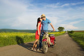 Couple kissing near motorbike — Stock Photo