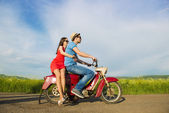 Couple on retro motorbike — Stock Photo