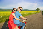 Couple on retro motorbike — Stock Photo