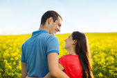 Couple in yellow field — Stock Photo