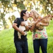 Couple walking with dogs — Stock Photo #46673703