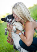 Woman is hugging her puppy — Stock Photo