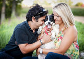 Couple hugging with dog — Stock Photo