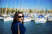 Female tourist at  boat harbor — Stock Photo