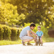 Father with son on motorbike — Stock Photo #47169385