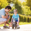 Father with son on motorbike — Stock Photo #47169441