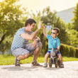 Father with son on motorbike — Stock Photo #47169461