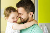 Father hugging his little daughter — Stock Photo