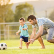 Father with son playing football — Stock Photo #47460803