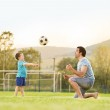 Father with son playing football — Stock Photo #47460875