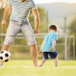 Father with son playing football — Stock Photo #47460903