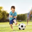 Father with son playing football — Stock Photo #47460913
